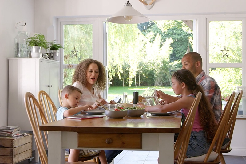 Family indoors eating dinner in their dining room, Video - Indoor Air Quality Affects Your Family's Health