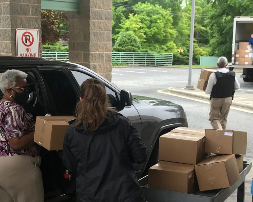 Boxes of meals being delivered by Meals on Wheels